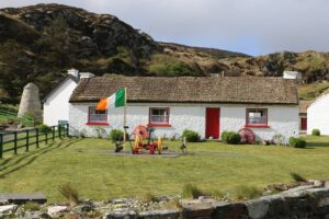 small irish cottage with thatched roof